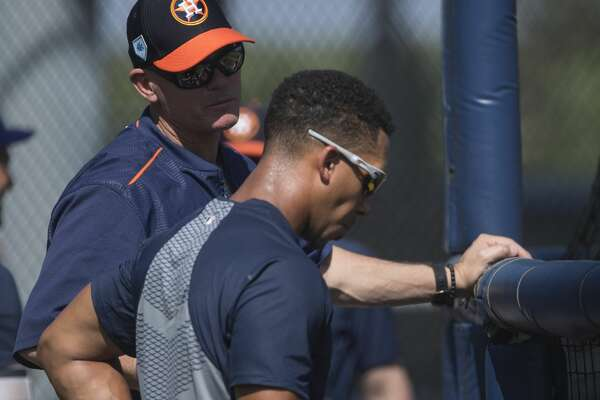Former Houston Astros player and Hall of Famer Craig Biggio, left, have a conversation with outfielder Michael Brantley during live batting practice at Fitteam Ballpark of The Palm Beaches on Day 6 of spring training on Tuesday, Feb. 19, 2019, in West Palm Beach.
