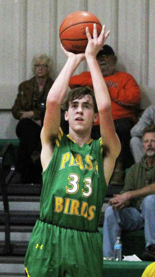Southwestern's Addis Moore scored 24 points, but the Piasa Birds dropped a 34-31 decision to Staunton in a quarterfinal game of the Piasa Class 2A regional Monday night. Photo: Telegraph File Photo