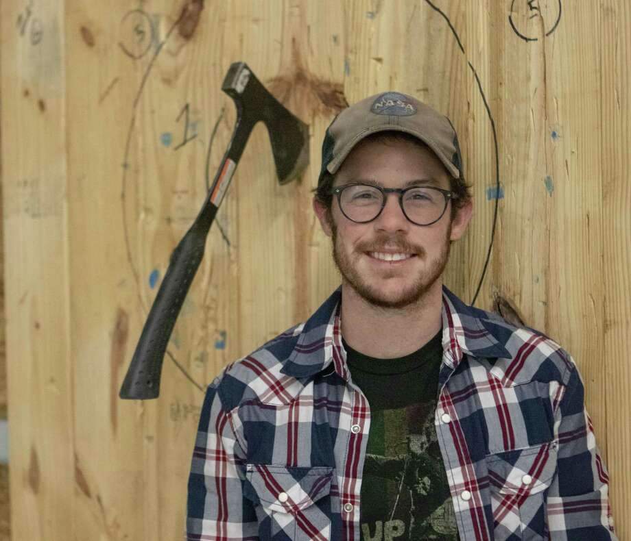 Texas Axe Throwing owner Nicolas Thering stands beside an axe throwing target Tuesday, Feb. 19, 2019 at Texas Axe Throwing in Spring. Photo: Cody Bahn, Houston Chronicle / Staff Photographer / © 2018 Houston Chronicle
