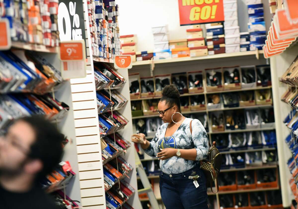 A woman shops at a Payless ShoeSource store in Orlando, Florida on February 17, 2019.