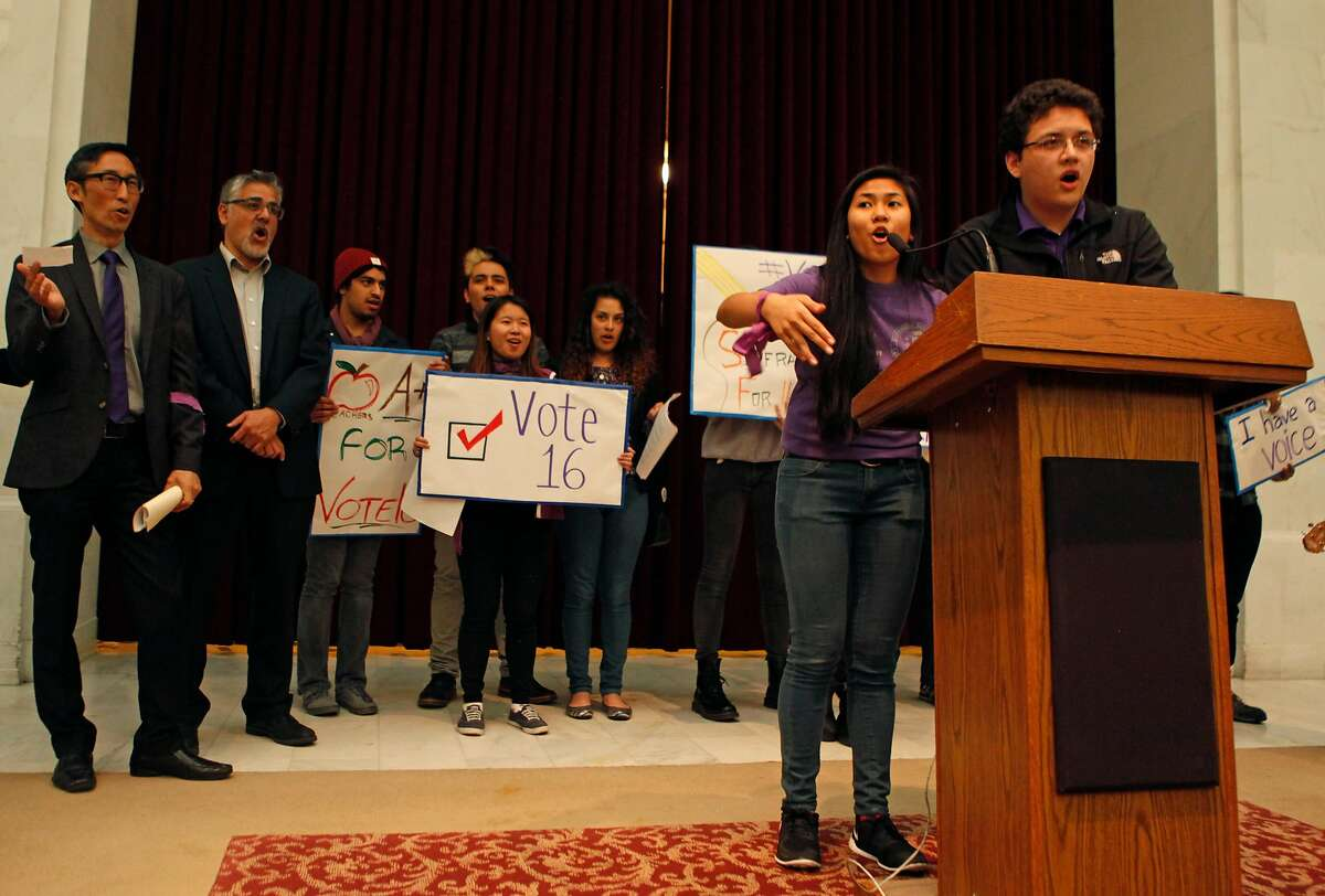 Two members of the San Francisco Youth Commission lead a chant during a rally held by the group at City Hall in San Francisco, Calif. Monday, March 16, 2015 to shine light on new legislation to allow 16 and 17-year-olds to vote in San Francisco.