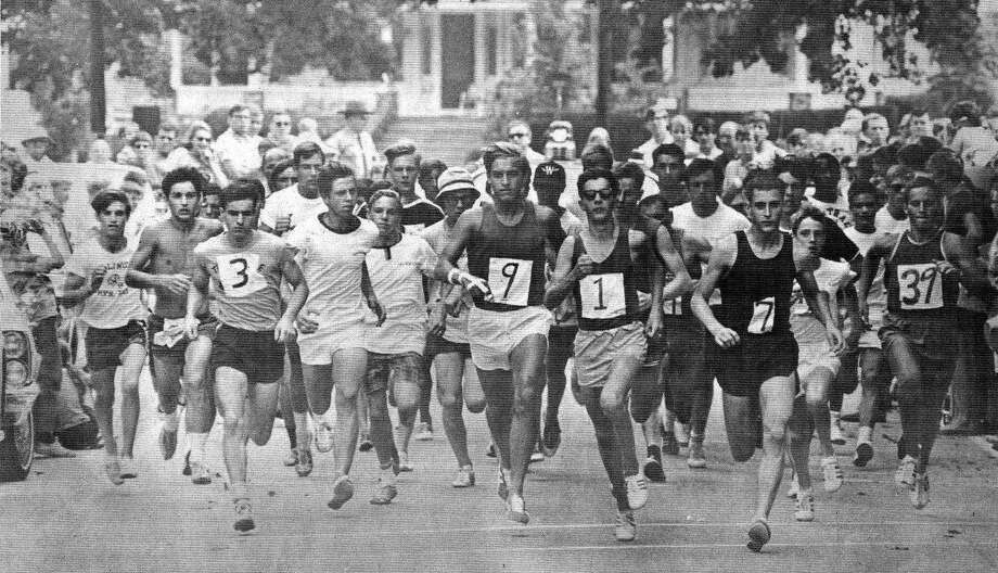 """One of the popular highlights of the Greater New Milford Chamber of Commerce's Village Fair Days is the 8-Mile Road Race. Above, the first 8-mile road race kicks off in July1968, with eventual champ Peter Squires (7), still a New Milford High School student-athlete, and ex-Green Wave track and cross country standout John """"Jack"""" Bucinsley (9) among the early frontrunners. This photo was shot for an area business tabloid newspaper of the era called The Advertiser and published along with many photographs of the Chamber of Commerce's inaugural Village Fair Days. If you have a """"Way Back When"""" photograph you'd like to share, contact Deborah Rose at drose@newstimes.com or 860-355-7324. Photo: Courtesy Of Lisa Appleyard / The News-Times Contributed"""