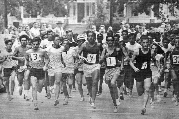 """One of the popular highlights of the Greater New Milford Chamber of Commerce's Village Fair Days is the 8-Mile Road Race. Above, the first 8-mile road race kicks off in July1968, with eventual champ Peter Squires (7), still a New Milford High School student-athlete, and ex-Green Wave track and cross country standout John """"Jack"""" Bucinsley (9) among the early frontrunners. This photo was shot for an area business tabloid newspaper of the era called The Advertiser and published along with many photographs of the Chamber of Commerce's inaugural Village Fair Days. If you have a """"Way Back When"""" photograph you'd like to share, contact Deborah Rose at drose@newstimes.com or 860-355-7324."""