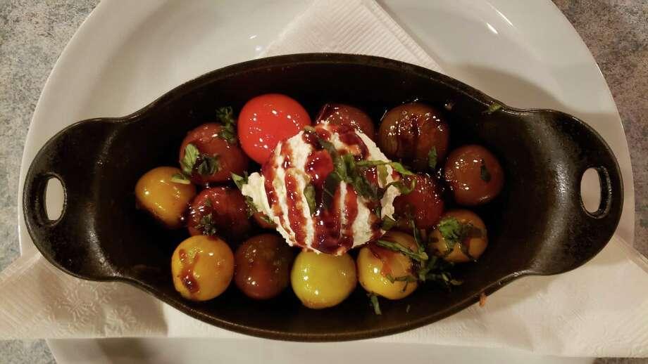 Blistered Heirloom Tomatoes served at Sandbar (recipe in column). Photo: Stephen Fries /