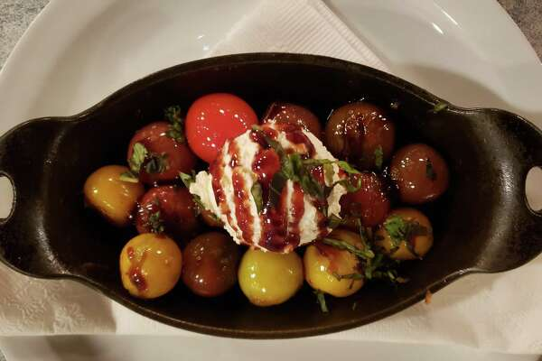 Blistered Heirloom Tomatoes served at Sandbar (recipe in column).