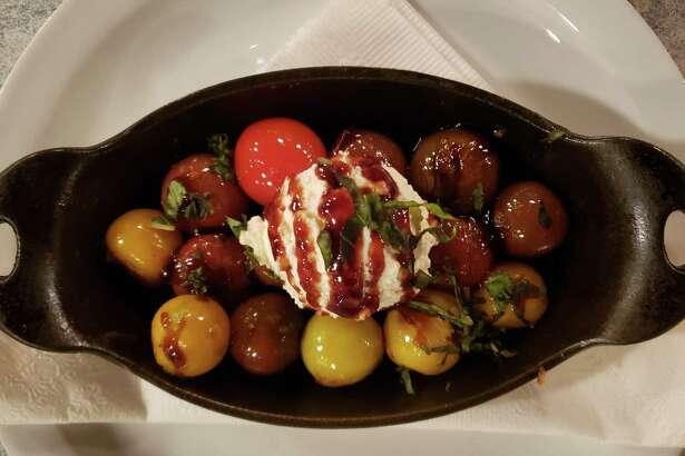 Blistered Heirloom Tomatoes served at Sandbar (recipe in column).