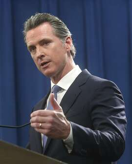 California Gov. Gavin Newsom discusses the lawsuit the state will likely file against President Donald Trump over his emergency declaration to fund a wall on the U.S.-Mexico border Friday, Feb. 15, 2019, in Sacramento, Calif. Newsom says there is no emergency at the border and Trump doesn't have the authority to make the declaration. (AP Photo/Rich Pedroncelli)