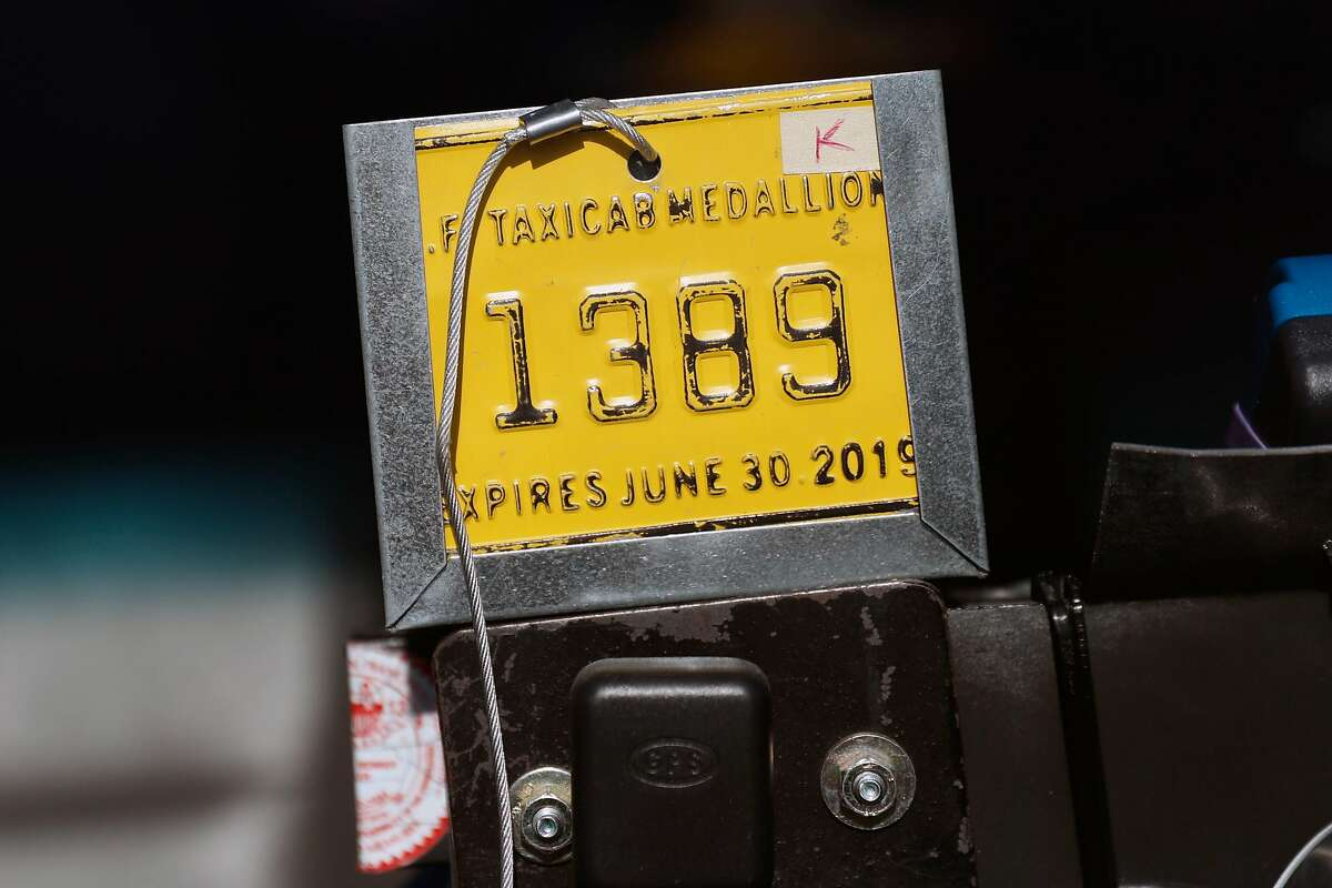 Taxi driver Marcelo Fonseco's K medallion in San Francisco, Calif., on Sunday, February 17, 2019.