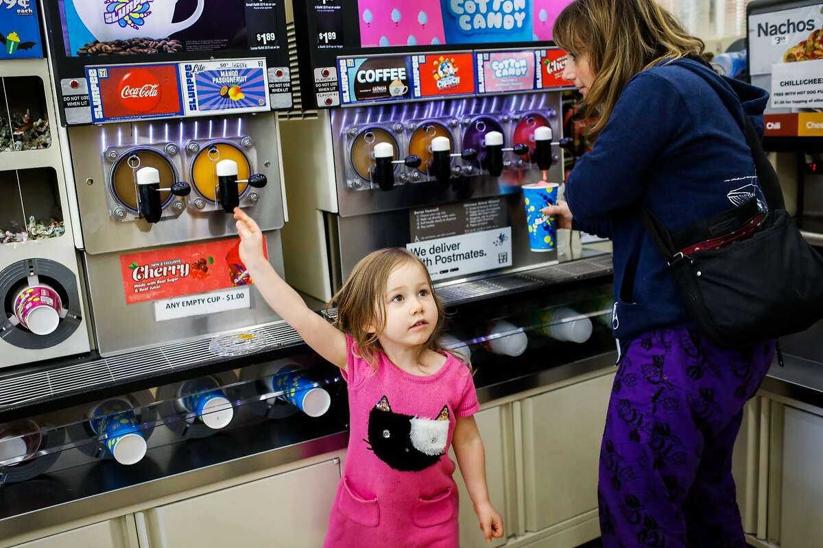 Meira Rose Lesle, 4 and her mother Alisa Dichter (right) get slurpees at 7-11 on Mission Street in San Francisco, California, on Monday, Feb. 18, 2019.