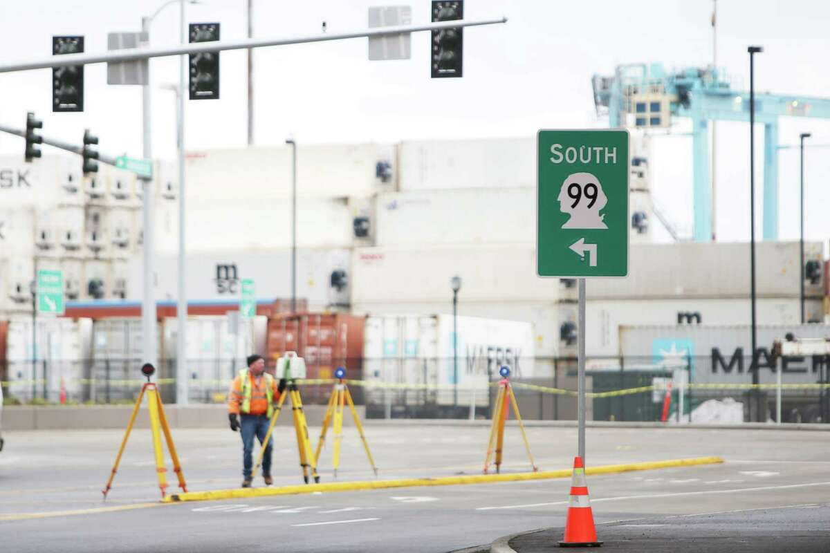 Transportation workers continue to do work near the new northbound SR 99 Dearborn Street exit which opened to traffic Tuesday morning before the morning rush, Jan. 19, 2019.