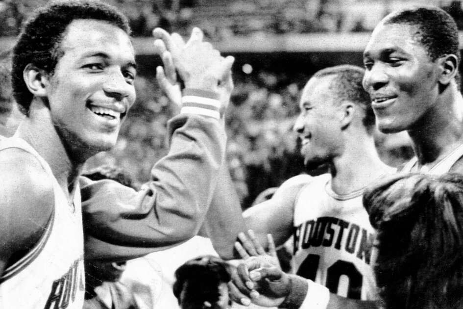 03/25/1983 - Savoring victory over the Memphis State Tigers Friday night are Houston Cougars (L-R) Clyde Drexler, Larry Micheaux and Akeem Olajuwon at the Midwest Regional Semifinal of the NCAA Tournament at Kemper Arena in Kansas City, Missouri.