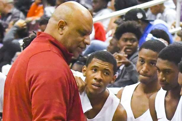 Yates coach Greg Wise, left, pictured during a game in November 2017, has led the Lions to four state championships.