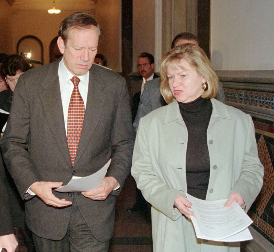 Zenia Mucha, right, speaks with New York Gov. George Pataki on the way to a news conference at the Capitol in Albany in 1996. (Associated Press archive) Photo: AP Archive / AP