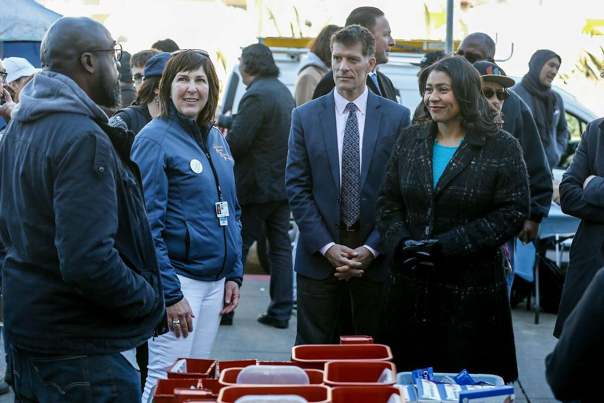 Grant Colfax, the city's new health director, receives a tour of the homelessness health fair with Mayor London Breed on his first day on the job on Tuesday, February 19, 2019 in San Francisco, Calif.