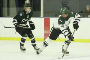 New Milford's Evan Golembeske, right, has been a leader on defense for the Green Wave.