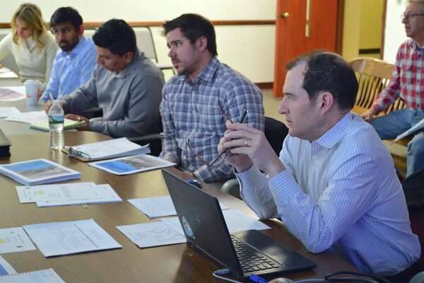 Victor Minerva, director of planning for consulting firm NV5, shares his thoughts at the Main to Train Technical Committee Working Group meeting on Tuesday, Feb. 19, 2019, in Town Hall, in Westport, Conn.