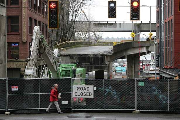 Work to dismantle the Alaksan Way Viaduct continued Tuesday at the Columbia Street onramp, Feb. 19, 2019.
