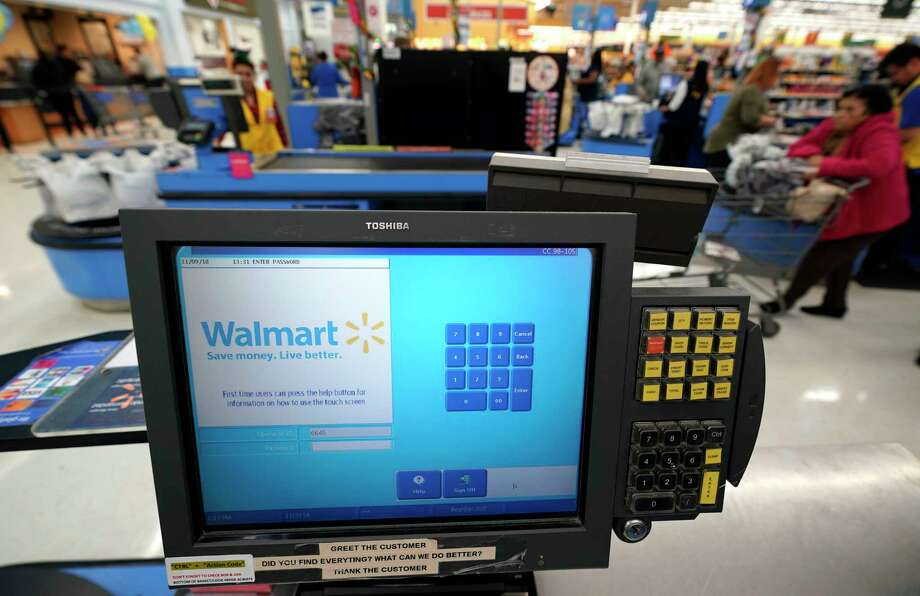 FILE- This Nov. 9, 2018, file photo shows a checkout scanner at a Walmart Supercenter in Houston. Walmart Inc. reports financial results Tuesday, Feb. 19, 2019. (AP Photo/David J. Phillip, File) Photo: David J. Phillip / Copyright 2018 The Associated Press. All rights reserved.