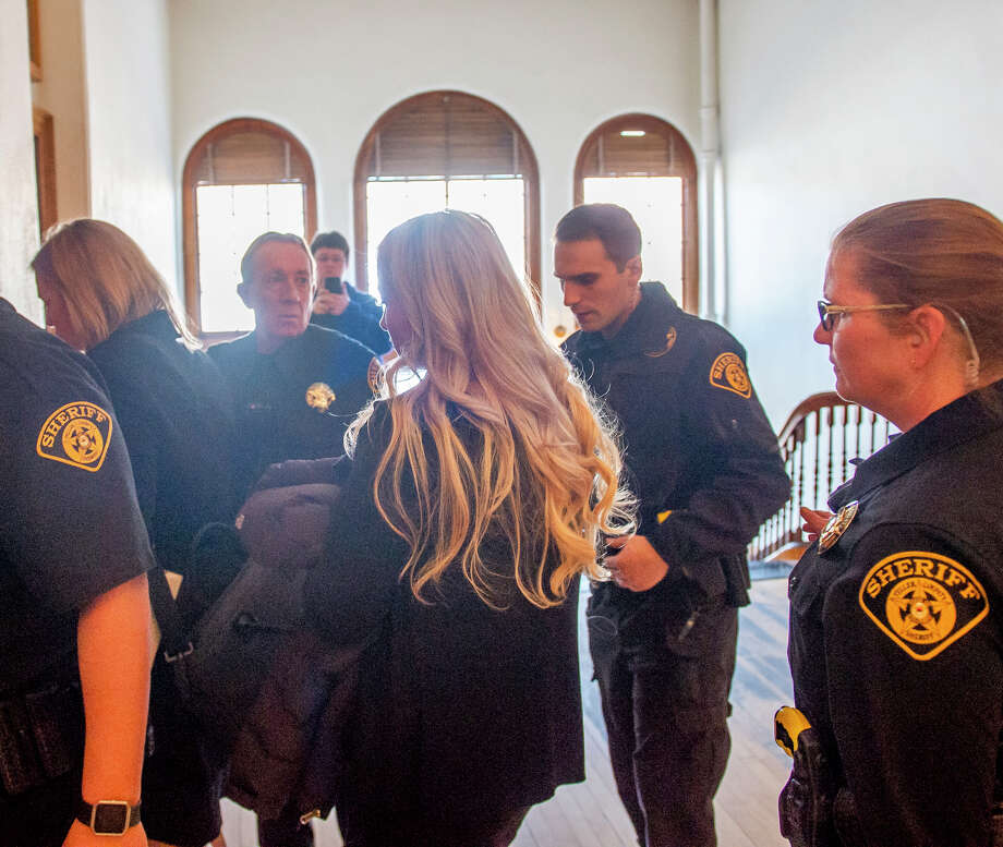 Krystal Jean Lee Kenney, 32, of Hansen, Idaho, center, exits to the court room and into the elevator after she accepted a plea deal and plea guilty to tampering with evidence in the disappearance and apparent murder of Kelsey Berreth of Woodland Park at the Teller Combined Court on Friday, Feb. 8, 2019 in Cripple Creek, Colo. (Dougal Brownlie/The Charleston Gazette-Mail via AP) Photo: Dougal Brownlie/AP / Dougal Brownlie, The Gazette