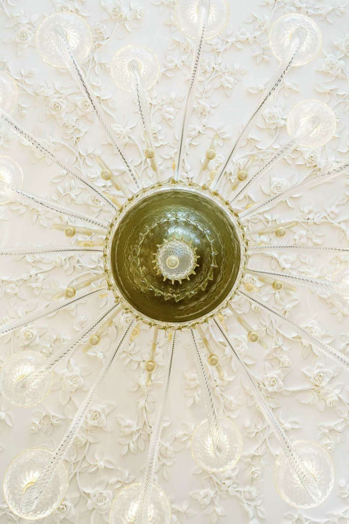 The rotunda of ValobraMaster Jewelers new store in River Oaks has a custom Venetian chandelier and ceiling sculptured with vines and roses.