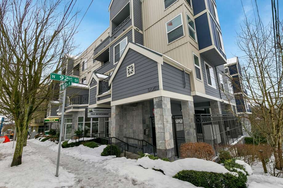 This one-bedroom condo in Greenwood has an open concept with new floors, a cozy fireplace and a private balcony with territorial views. There's plenty of shiny new features including stainless appliances, WiFi-enabled smart lighting and a newer water heater.