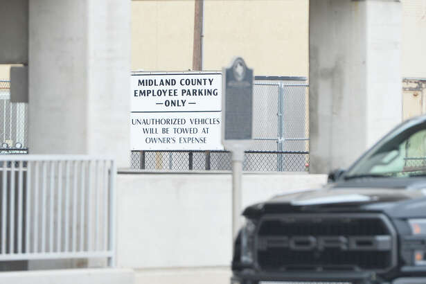 Signage in a parking lot located behind the Midland County Historical Museum building near the intersection of N. Main Street and E. Texas Ave. close to the Municipal Couthouse, Feb. 19, 2019. James Durbin/Reporter-Telegram