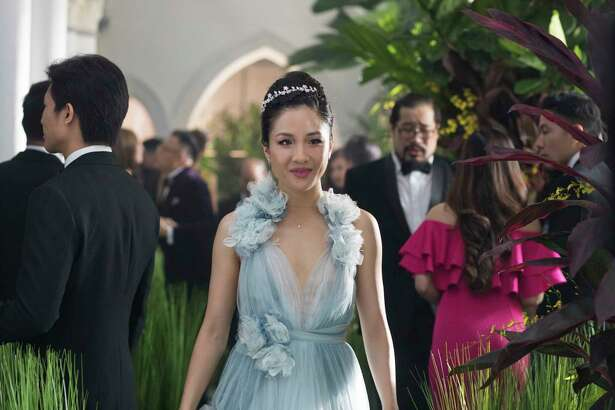 """This image released by Warner Bros. Entertainment shows Constance Wu in a scene from the film """"Crazy Rich Asians."""" (Sanja Bucko/Warner Bros. Entertainment via AP)"""