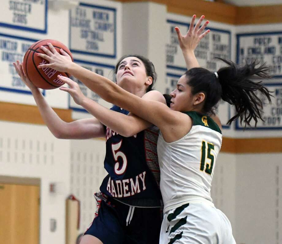 Greenwich Academy's Tina Maldonado, right, fouls Greens Farms Academy's Sarah Peltier during their FAA quarterfinal on Tuesday. The Gators won 45-37. Photo: Contributed Photo / Greenwich Time Contributed