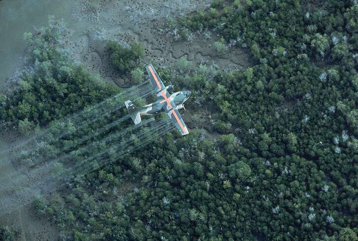 A U.S. Air Force plane spraying delta area with Agent Orange during Vietnam war, 1970.