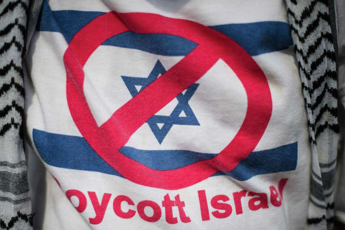 (FILES) In this file photo taken on July 17, 2014 a supporter wears a T-shirt reading 'Boycott Israel' at the Palestinian embassy in Kuala Lumpur, during a rally against Israeli air strikes on Gaza. - The US Senate passed a controversial measure February 5, 2019, designed to shield Israel from boycotts, but its adoption remains uncertain in the Democratically-controlled lower House, where liberal lawmakers warn the approach tramples free-speech rights. The Middle East security bill aims to combat the global BDS (boycott, divestment and sanctions) movement that denounces Israel's occupation of Palestinian territories and pressures companies that do business with the Jewish state. (Photo by Mohd RASFAN / AFP)MOHD RASFAN/AFP/Getty Images