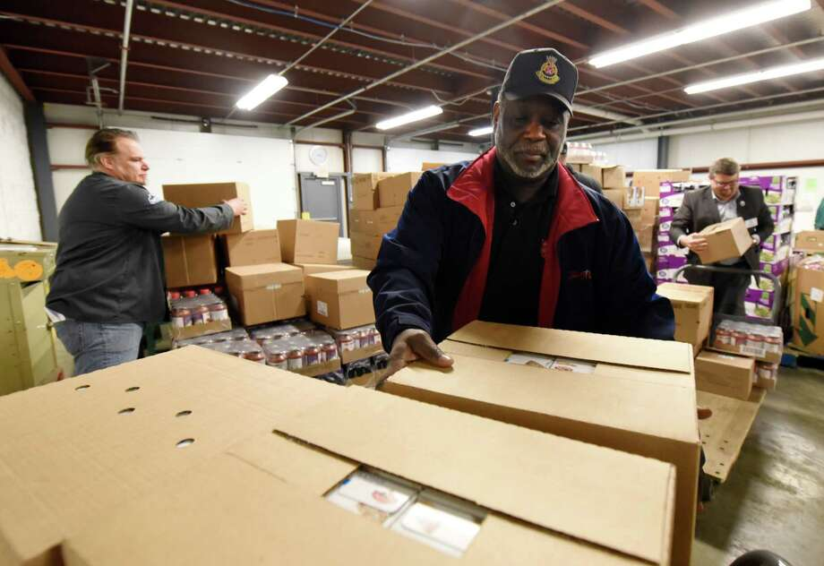 Pastor James Pegues from the Troy Salvation Army participates in the ceremonial distribution from the new dock on Tuesday, Feb. 19, 2019 at Regional Food Bank of NENY in Latham, NY. (Phoebe Sheehan/Times Union) Photo: Phoebe Sheehan / 40046224A