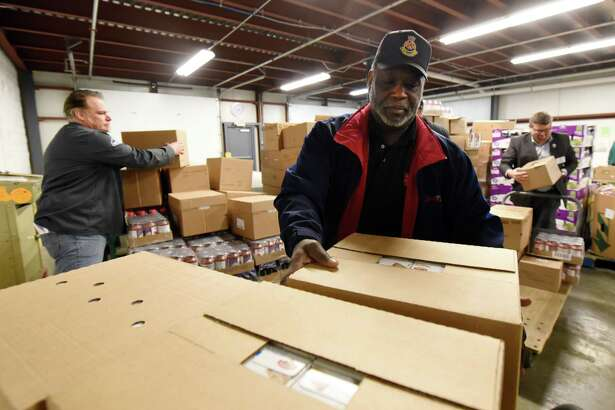 Pastor James Pegues from the Troy Salvation Army participates in the ceremonial distribution from the new dock on Tuesday, Feb. 19, 2019 at Regional Food Bank of NENY in Latham, NY. (Phoebe Sheehan/Times Union)