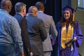 MISD graduates walk across the stage 02/19/2019 at Bowie Fine Arts Academy, congratulated by school board members for their mid-year graduation. Tim Fischer/Reporter-Telegram