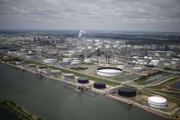 Oil refinery storage tanks stand in this aerial photograph taken above Texas City, Texas, U.S., on Wednesday, Aug. 30, 2017. Unprecedented flooding from the Category 4 storm that slammed into the state's coast last week, sendinggasoline pricessurging as oil refineries shut, may also set a record for rainfall in the contiguous U.S., the weather service said Tuesday. Photographer: Luke Sharrett/Bloomberg