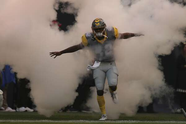 San Diego Fleet linebacker Eric Pinkins (42) runs through the smoke during  pregame introductions before an AAF football game between the Atlanta  Legends and ... 6d6d66f6c
