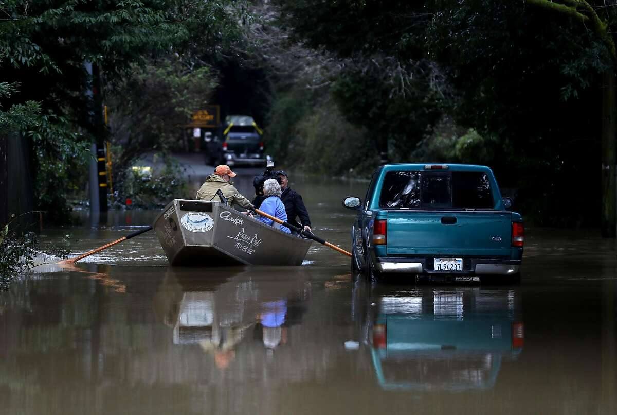 GUERNEVILLE, CALIFORNIA - FEBRUARY 15: Residents use a boat to navigate floodwaters on February 15, 2019 in Guerneville, California. An atmospheric river, a narrow corridor of concentrated moisture in the atmosphere, is bringing heavy rains to Northern California that is causing rivers to overflow their banks and flood many areas around the Russian River. (Photo by Justin Sullivan/Getty Images) ***BESTPIX***