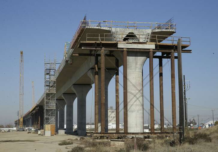 FILE - This Dec. 6, 2017, file photo shows one of the elevated sections of the high-speed rail under construction in Fresno, Calif. During his first State of the State speech last week, Gov. Gavin Newsom said that he is committed to finishing the Central Valley portion of the bullet train. (AP Photo/Rich Pedroncelli, file)