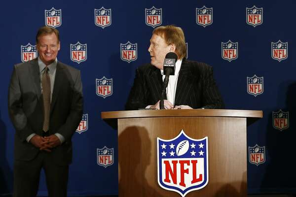 Oakland Raiders owner Mark Davis, right, looks over at NFL Commissioner Roger Goodell, left, during a news conference after owners approved the move of the Raiders to Las Vegas, Monday, March 27, 2017, in Phoenix. (AP Photo/Ross D. Franklin)