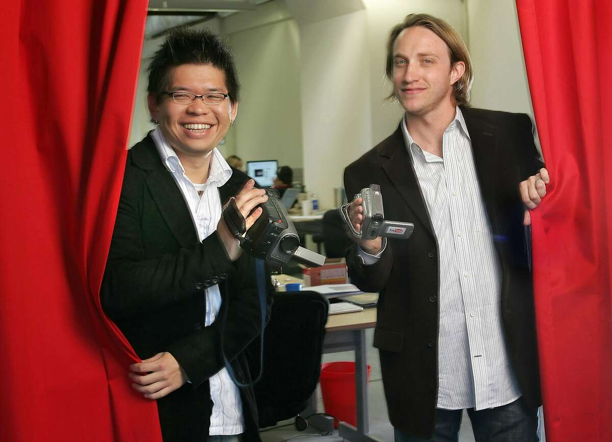YouTube cofounders Chad Hurley, 29, right, and Steven Chen, 27, pose for a photo with their video cameras at their office loft in San Mateo, Calif., Wednesday, March 29, 2006. Google Inc. is snapping up YouTube Inc. for $1.65 billion in a deal that catapults the Internet search leader to a starring role in the online video revolution. The all-stock deal announced Monday unites one of the Internet's marquee companies with one of its rapidly rising stars. (AP Photo/ Tony Avelar)