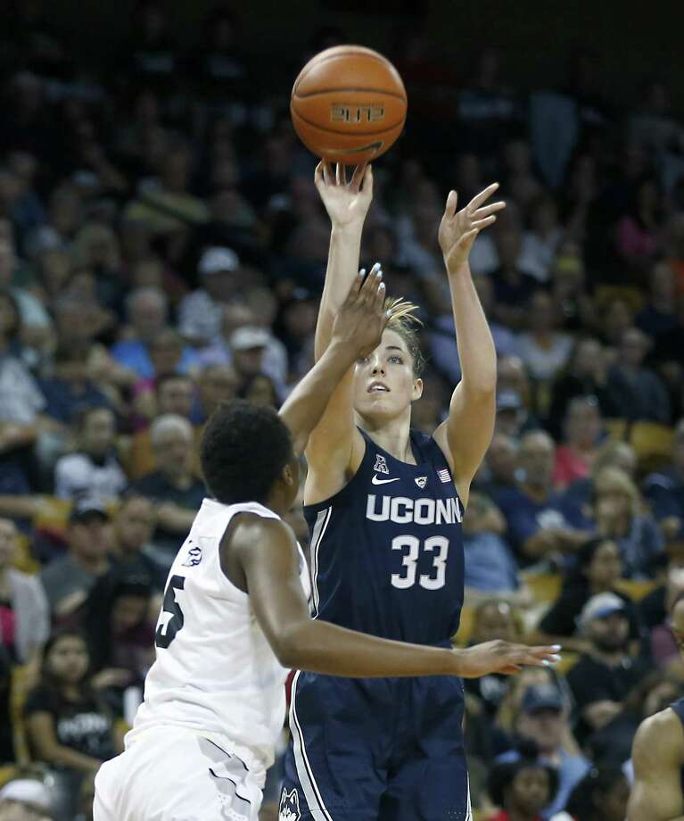 UConn's Katie Lou Samuelson (33) shoots over Central Florida forward Masseny Kaba (5) on Sunday in Orlando, Fla. Photo: Reinhold Matay / Associated Press / Reinhold Matay