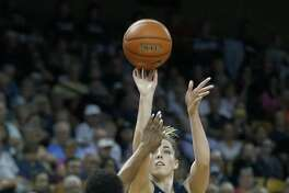 UConn's Katie Lou Samuelson (33) shoots over Central Florida forward Masseny Kaba (5) on Sunday in Orlando, Fla.