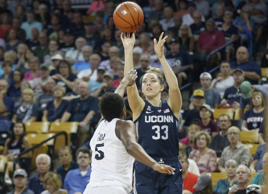 UCon's Katie Lou Samuelson shoots over Central Florida forward Masseny Kaba during the first quarter in Orlando Fla. on Feb. 17. Photo: Reinhold Matay / Associated Press / Reinhold Matay