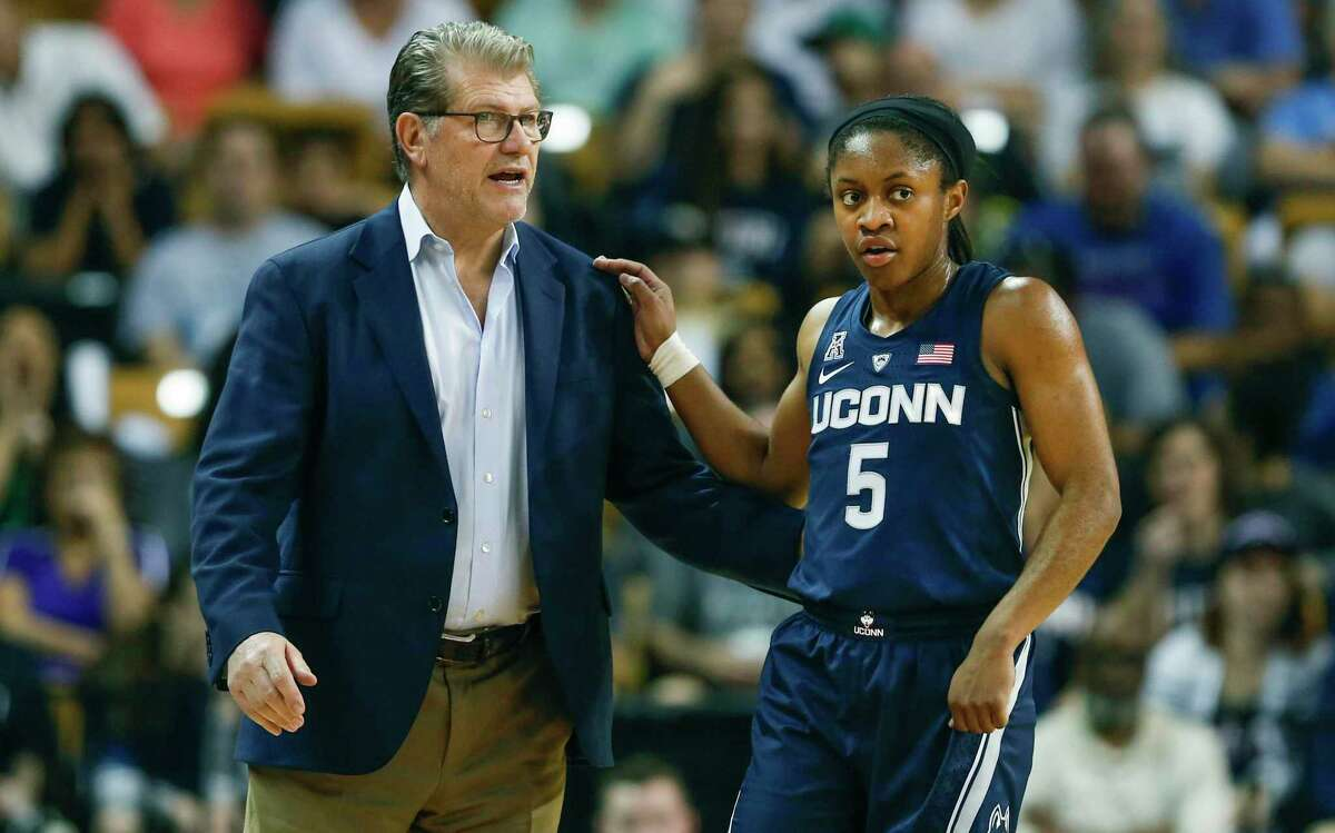 UConn guard Crystal Dangerfield talks to head coach Geno Auriemma during the first quarter of an NCAA college basketball game against Central Florida in Orlando, Fla., on Sunday, Feb. 17, 2019.