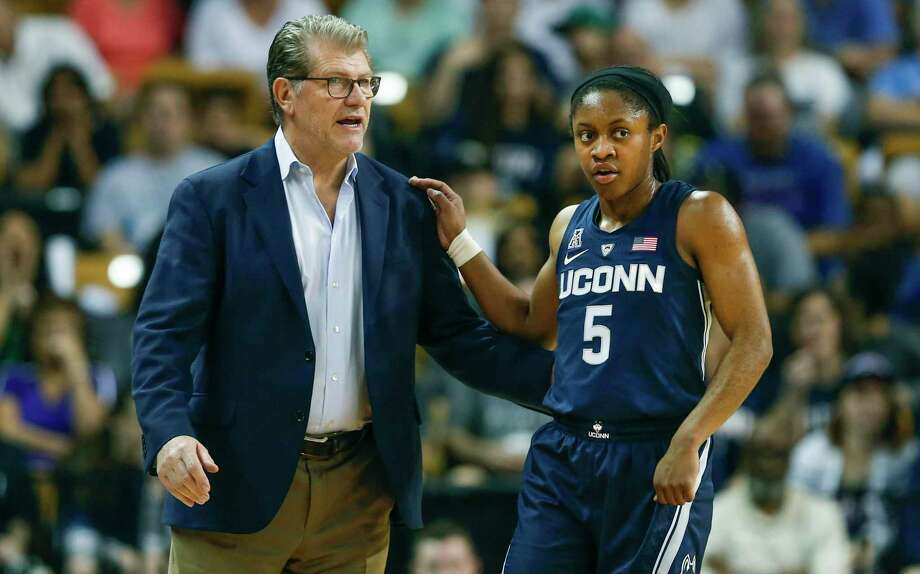 UConn guard Crystal Dangerfield talks to head coach Geno Auriemma during the first quarter of an NCAA college basketball game against Central Florida in Orlando, Fla., on Sunday, Feb. 17, 2019. Photo: Reinhold Matay / Associated Press / Reinhold Matay