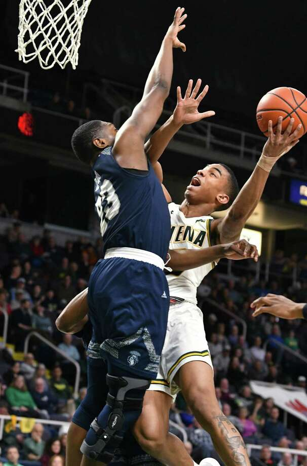 Siena's Manny Camper drives to the hoop against Saint Peter's Samuel Idowu during a basketball game at the Times Union Center on Tuesday, Feb. 19, 2019 in Albany, N.Y. (Lori Van Buren/Times Union) Photo: Lori Van Buren, Albany Times Union / 20044860A