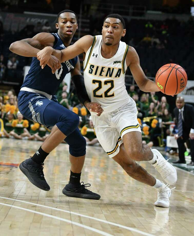 Siena's Jalen Pickett drives to the basket against Saint Peter's Dallas Watson during a basketball game at the Times Union Center on Tuesday, Feb. 19, 2019 in Albany, N.Y. (Lori Van Buren/Times Union) Photo: Lori Van Buren, Albany Times Union / 20044860A