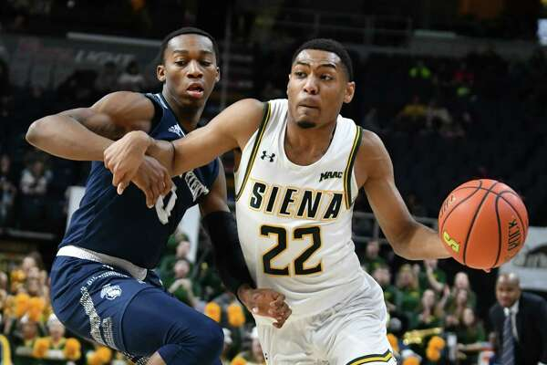 Siena's Jalen Pickett drives to the basket against Saint Peter's Dallas Watson during a basketball game at the Times Union Center on Tuesday, Feb. 19, 2019 in Albany, N.Y. (Lori Van Buren/Times Union)