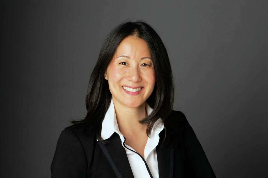 This 2019 photo provided by USA Gymnastics shows Li Li Leung. USA Gymnastics is turning to NBA executive Li Li Leung to help turn the embattled program around. The organization named Leung as its new president and chief executive officer on Tuesday, Feb. 19, 2019,  as it fights to retain its status as the national governing body for the sport after the Larry Nassar sexual abuse scandal. Leung served as vice president of global partnerships for the NBA. She arrives as USA Gymnastics attempts to fend off decertification from the United States Olympic Committee. (Wendy Barrows Photography/USA Gymnastics via AP) Photo: WENDY BARROWS Photography / copyright 2019 WENDY BARROWS