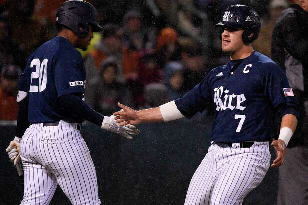Rice's Dominic DiCaprio (7) celebrates with Dominic Cox after scoring a run on Antonio Cruz's RBI single during the second inning of an NCAA college baseball game against Texas, Tuesday, Feb. 19, 2019, in Houston.