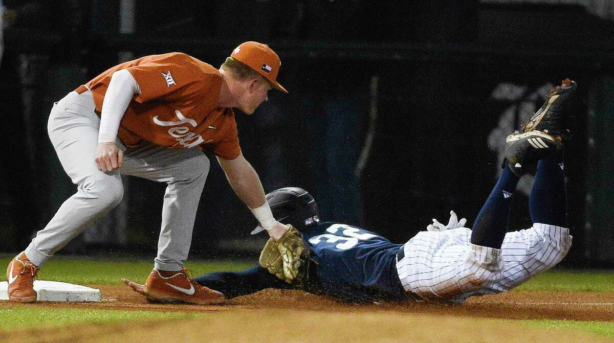Texas third baseman Aaron Beaulaurier, left, tags out Rice's Ty Madden after Madden tried to advance on a sacrifice during the first inning of an NCAA college baseball game, Tuesday, Feb. 19, 2019, in Houston.